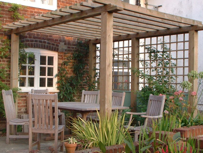 Making the most of this garden with an arbour dining area.
