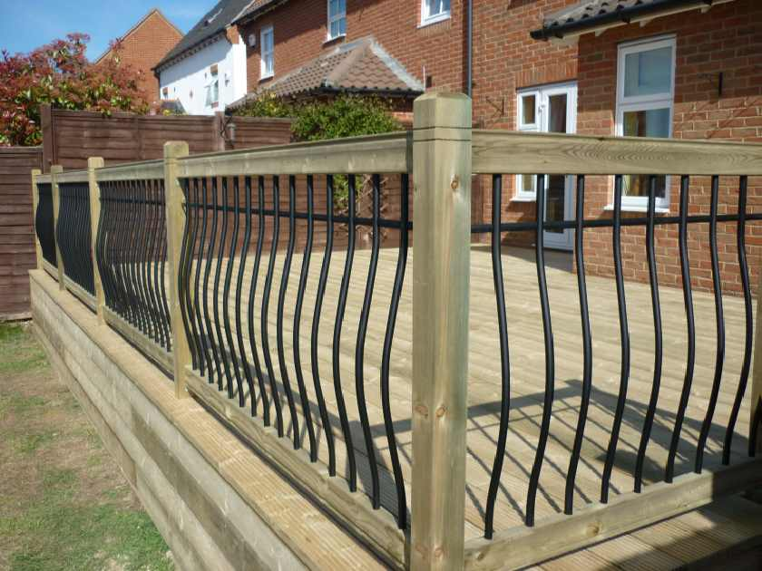 Softwood deck with black metal and timber balustrade