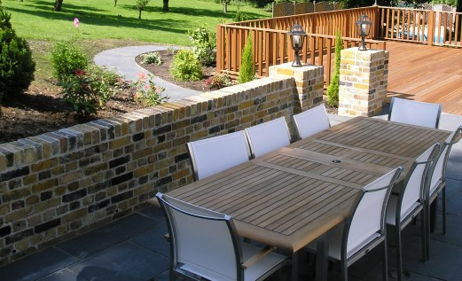 Garden brickwork from recycled bricks with lime stone paving, path, hard wood deck, balustrade and teak 8 seater dining set