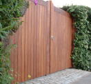 Timber entrance gates in tongue and groove panel construction, made from Iroko hard wood.