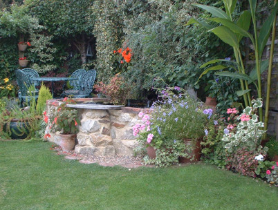 Raised pond is the key to this garden's success.