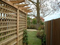 This garden offers many features including arbour dining area, paving, stepping stone path and deck.