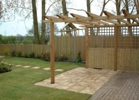 Large arbour with a practical paved area.