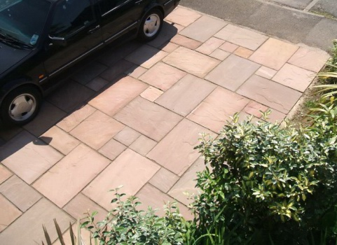 This front garden patio in modak / brown stone is strong enough to park on