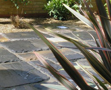 A garden patio built using Indian sandstone in black colour.