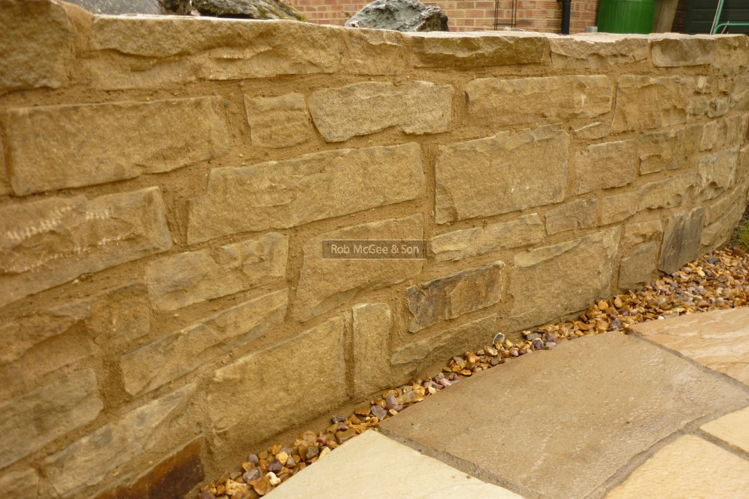 Yorkstone Low Level Garden Wall With Fossil Cream Sandstone Circle. Hard  Landscaping From Rob McGee U0026 Son.